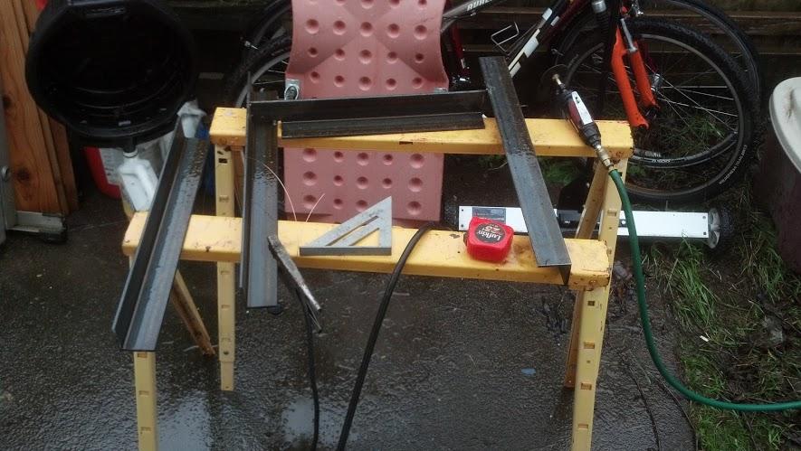 Scheming the pieces (in the rain). Welding too!